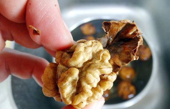 Remove walnut peel manually