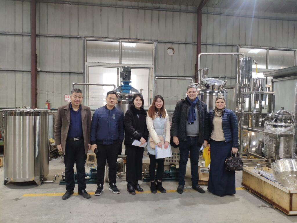 Visit the peanut processing machine factory with customers